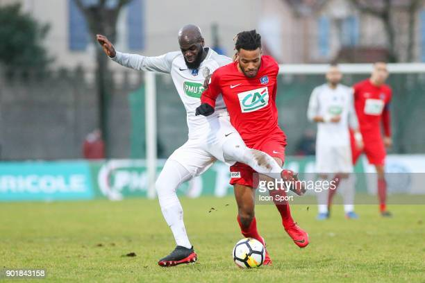 Armand Tailly of Houilles and Julio Donisa of Concarneau during the french National Cup match between Houilles and Concarneau on January 6 2018 in...