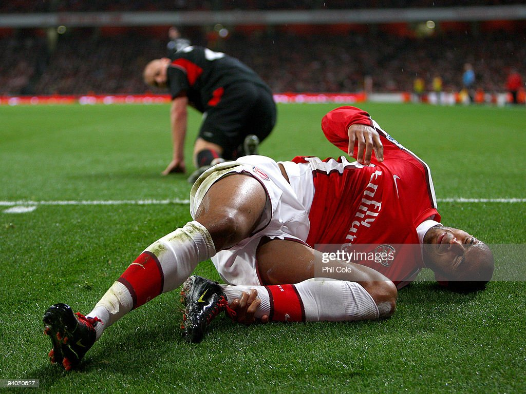Armand Traore of Arsenal holds his shin after a tackle by Andy Wilkinson of Stoke City during the Barclays Premier League match between Arsenal and Stoke City at the Emirates Stadium on December 5, 2009 in London, England.