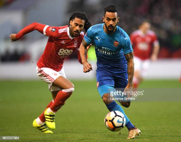 Armand Traore of Nottingham Forest chases down Theo Walcott of Arsenal during The Emirates FA Cup Third Round match between Nottingham Forest and...