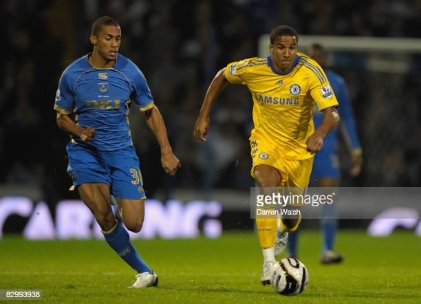 Armand Traore of Portsmouth closes down Scott Sinclair of Chelsea during the Carling Cup 3rd Round match between Portsmouth and Chelsea held at...