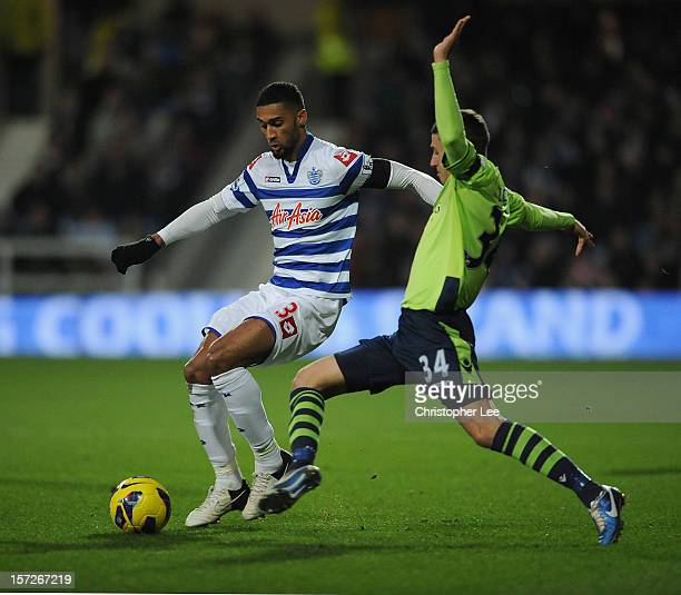 Armand Traore of Queens Park Rangers is tackled by Matthew Lowton of Aston Villa during the Barclays Premier League match between Queens Park Rangers...
