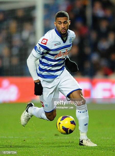 Armand Traore of Queens Park Rangers runs with the ball during the Barclays Premier League match between Queens Park Rangers and Aston Villa at...