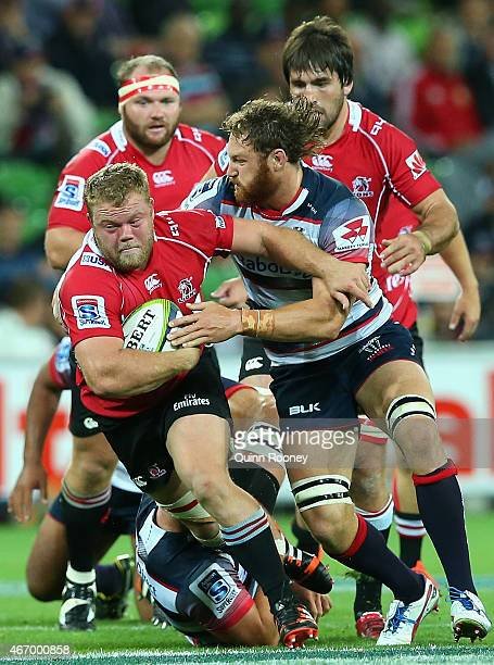 Armand Van Der Merwe of the Lions is tackled by Scott Higginbotham of the Rebels during the round six Super Rugby match between the Rebels and the...