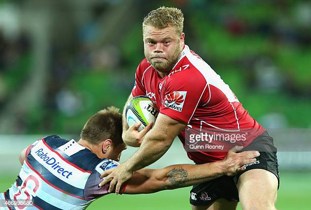 Armand Van Der Merwe of the Lions is tackled by Sean McMahon of the Rebels during the round six Super Rugby match between the Rebels and the Lions at...