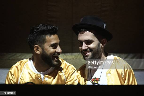 Armand Van Helden and ATrak of Duck Sauce perform on stage during day 1 of the 2013 Hard Music Festival at Los Angeles State Historic Park on August...