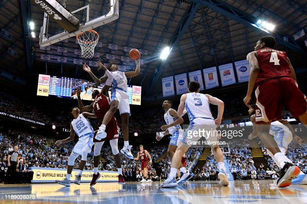 Armando Bacot of the North Carolina Tar Heels takes a rebound away from Chuck Hannah of the Elon Phoenix during the first half of their game at the...