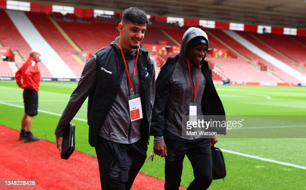 Armando Broja and Moussa Djenepo of Southampton arrive ahead of the Premier League match between Southampton and Burnley at St Mary's Stadium on...