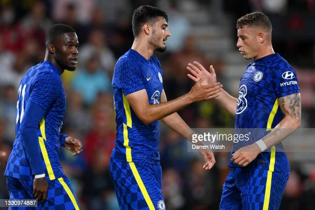Armando Broja of Chelsea celebrates with teammate Ross Barkley after scoring their team's first goal during the Pre-Season Friendly between...