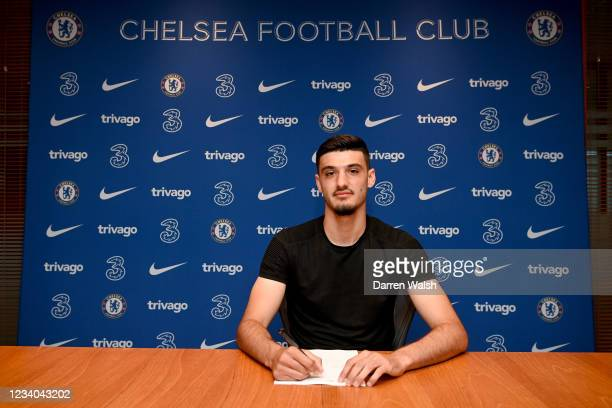 Armando Broja of Chelsea signs a contract extension at Stamford Bridge on July 18, 2021 in London, England.