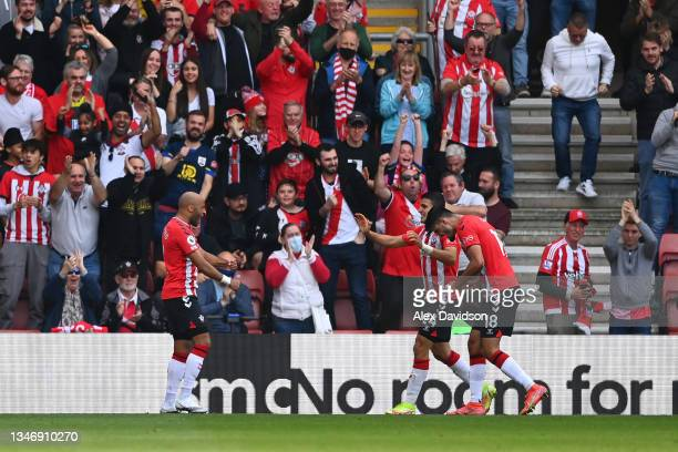 Armando Broja of Southampton celebrates with Nathan Redmond and Mohamed Elyounoussi after scoring their team's first goal during the Premier League...