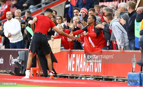 Armando Broja of Southampton gives his shirt to a fan during the Premier League match between Southampton and Burnley at St Mary's Stadium on October...