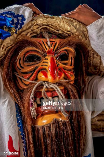 Armando Castelan Simon poses for a photograph with his costume during the presentation of the Huey Atlixcayotl Festival on September 29 2018 in...