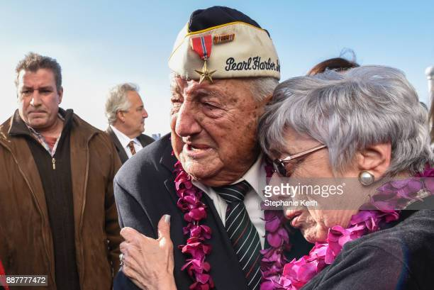 Armando 'Chick' Galella gets emotional after a wreathlaying ceremony aboard the Intrepid Sea Air and Space Museum the on December 7 2017 in New York...