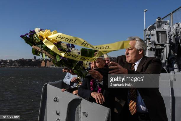 Armando 'Chick' Galella with his son Michael Galella throws a wreath at a wreathlaying ceremony aboard the Intrepid Sea Air and Space Museum the on...