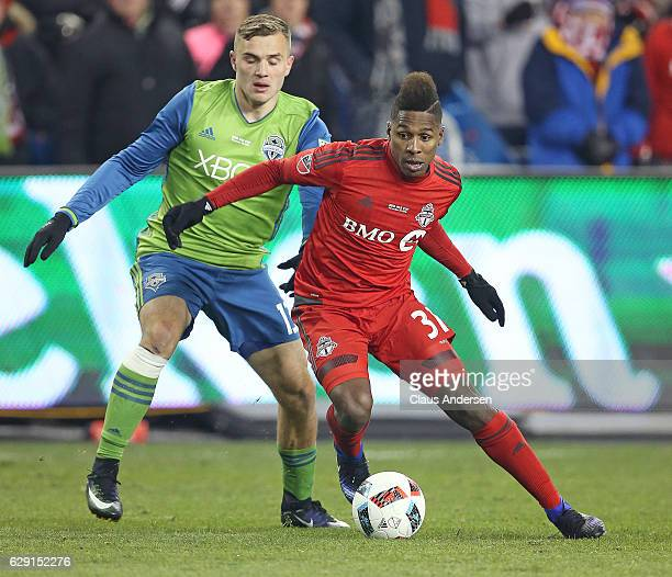 Armando Cooper of the Toronto FC looks to get away from Jordan Morris of the Seattle Sounders during the 2016 MLS Cup at BMO Field on December 10...