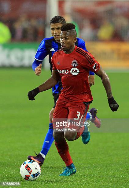 Armando Cooper of Toronto FC and Johan Venegas of Montreal Impact battle for the ball during the second half of the MLS Eastern Conference Final Leg...