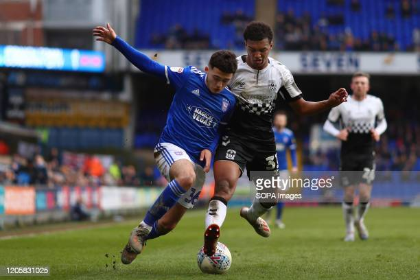 Armando Dobra of Ipswich Town and Sam McCallum of Coventry City are seen in action during the Sky Bet League One match between Ipswich Town and...