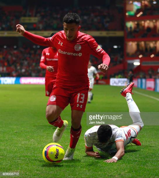 Armando Escobar of Alebrijes and Aldo Benitez of Toluca compete for the ball during the round of 16th match between Toluca and Alebrijes as part of...