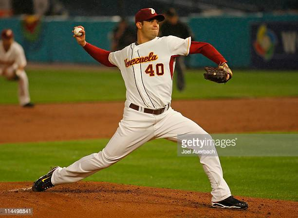 Armando Galarraga of Venezuela throws the ball against the USA during the World Baseball Classic at Dolphin Stadium on March 18 2009 in Miami Florida...