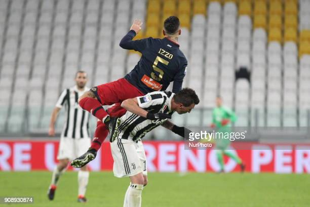 Armando Izzo and Mario Mandzukic during the Serie A football match between Juventus FC and Genoa CFC at Allianz Stadium on 22 January 2018 in Turin...