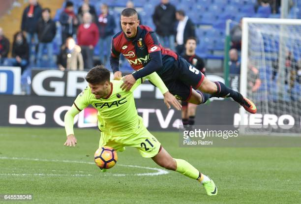 Armando Izzo of Genoa and Bruno Petkovic of Bologna in action during the Serie A match between Genoa CFC and Bologna FC at Stadio Luigi Ferraris on...