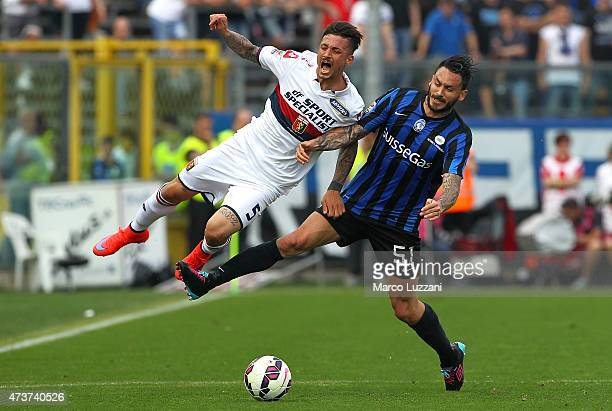 Armando Izzo of Genoa CFC clashes with Mauricio Pinilla of Atalanta BC during the Serie A match between Atalanta BC and Genoa CFC at Stadio Atleti...