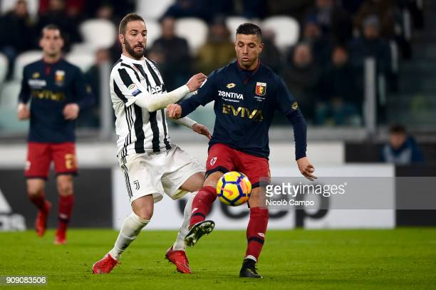 Armando Izzo of Genoa CFC competes for the ball with Gonzalo Higuain of Juventus FC during the Serie A football match between Juventus FC and Genoa...