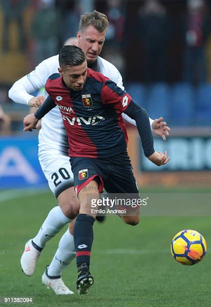 Armando Izzo of Genoa CFC competes for the ball with Maxi Lopez of Udinese Calcio during the serie A match between Genoa CFC and Udinese Calcio at...