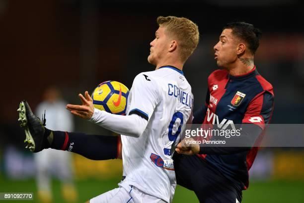 Armando Izzo of Genoa CFC competes with Andreas Cornelius of Atalanta BC during the Serie A match between Genoa CFC and Atalanta BC at Stadio Luigi...