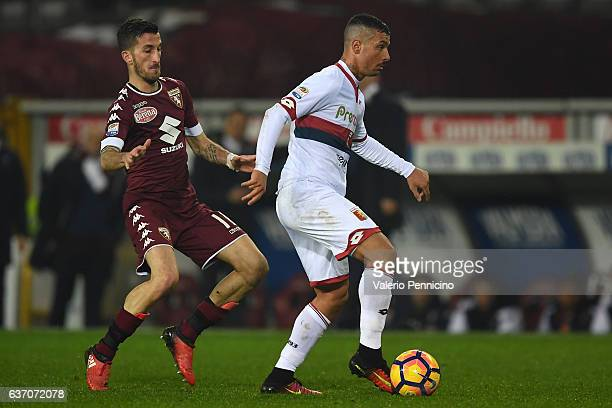 Armando Izzo of Genoa CFC in action against Mirko Valdifiori of FC Torino during the Serie A match between FC Torino and Genoa CFC at Stadio Olimpico...