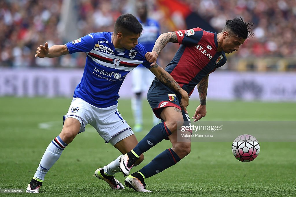 Armando Izzo (R) of Genoa CFC is challenged by Carlos Joaquin Correa of UC Sampdoria during the Serie A match between UC Sampdoria and Genoa CFC at Stadio Luigi Ferraris on May 8, 2016 in Genoa, Italy.