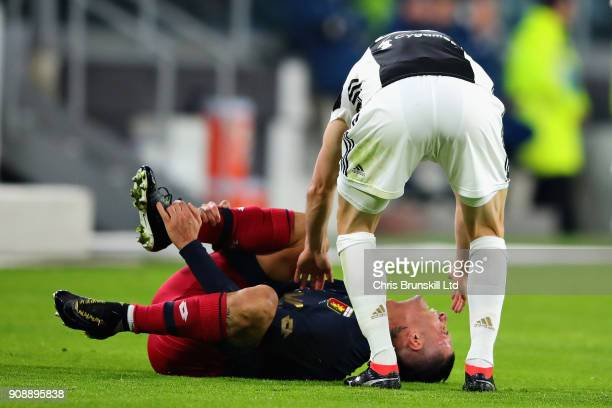 Armando Izzo of Genoa CFC is checked on by Stephan Lichtsteiner of Juventus following a collision during the Serie A match between Juventus and Genoa...