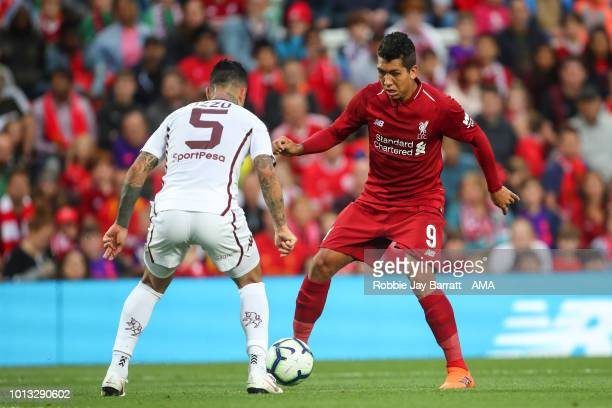 Armando Izzo of Torino and Roberto Firmino of Liverpool during the preseason friendly between Liverpool and Torino at Anfield on August 7 2018 in...
