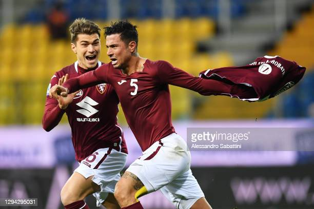 Armando Izzo of Torino celebrates after scoring their sides second goal with Jacopo Segre of Torino during the Serie A match between Parma Calcio and...
