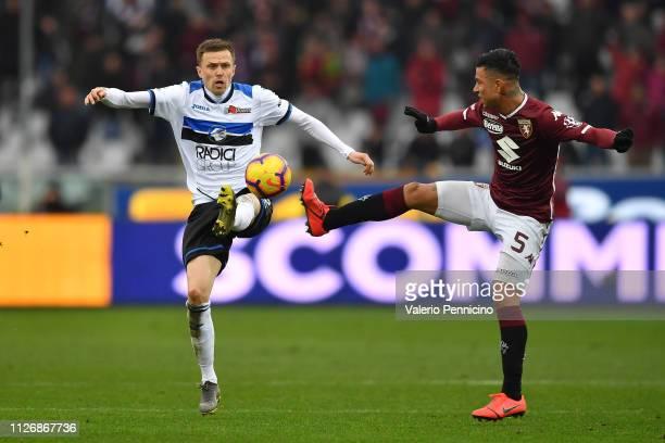 Armando Izzo of Torino FC clashes with Josip Ilicic of Atalanta BC during the Serie A match between Torino FC and Atalanta BC at Stadio Olimpico di...