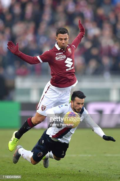 Armando Izzo of Torino FC clashes with Nicola Sansone of Bologna FC during the Serie A match between Torino FC and Bologna FC at Stadio Olimpico di...