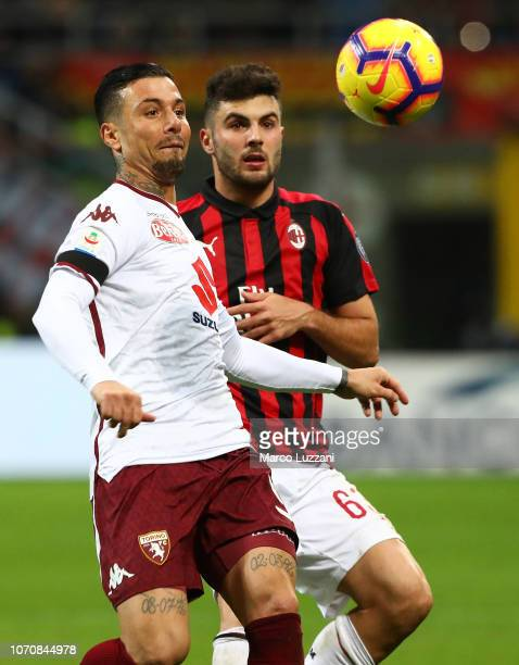 Armando Izzo of Torino FC competes for the ball with Patrick Cutrone of AC Milan during the Serie A match between AC Milan and Torino FC at Stadio...