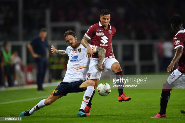 Armando Izzo of Torino FC competes with Andrea Tabanelli of US Lecce during the Serie A match between Torino FC and US Lecce at Stadio Olimpico di...