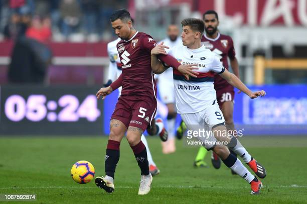 Armando Izzo of Torino FC competes with Armando Izzo of Genoa CFC during the Serie A match between Torino FC and Genoa CFC at Stadio Olimpico di...