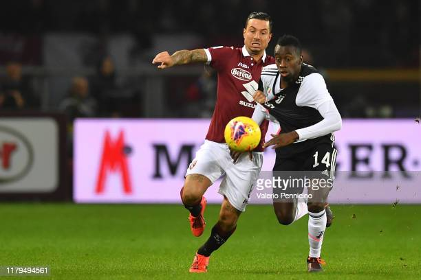 Armando Izzo of Torino FC competes with Blaise Matuidi of Juventus during the Serie A match between Torino FC and Juventus at Stadio Olimpico di...