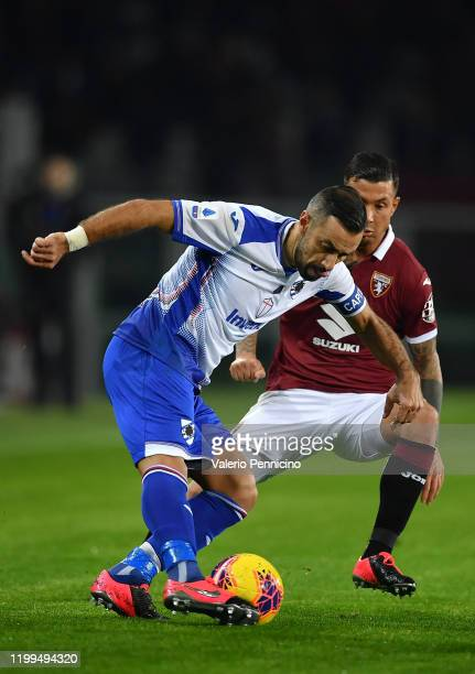 Armando Izzo of Torino FC competes with Fabio Quagliarella of UC Sampdoria during the Serie A match between Torino FC and UC Sampdoria at Stadio...