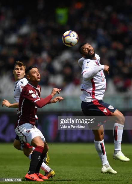 Armando Izzo of Torino FC competes with Galvao Joao Pedro of Cagliari during the Serie A match between Torino FC and Cagliari at Stadio Olimpico di...