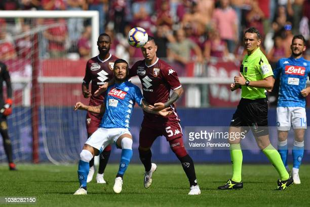 Armando Izzo of Torino FC competes with Lorenzo Insigne of SSC Napoli during the Serie A match between Torino FC and SSC Napoli at Stadio Olimpico di...