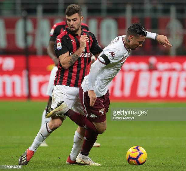 Armando Izzo of Torino FC is challenged by Patrick Cutrone of AC Milan during the Serie A match between AC Milan and Torino FC at Stadio Giuseppe...