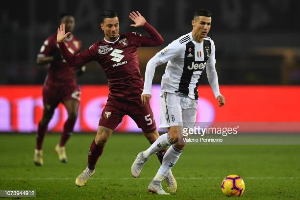 Armando Izzo of Torino FC tackles Cristiano Ronaldo of Juventus during the Serie A match between Torino FC and Juventus at Stadio Olimpico di Torino...