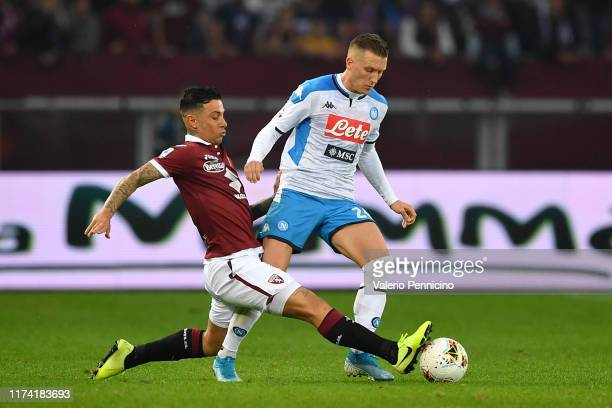 Armando Izzo of Torino FC tackles Piotr Zielinski of SSC Napoli during the Serie A match between Torino FC and SSC Napoli at Stadio Olimpico di...