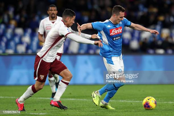 Armando Izzo of Torino FC vies with Arkadiusz Milik of SSC Napoli during the Serie A match between SSC Napoli and Torino FC at Stadio San Paolo on...