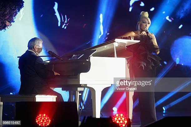 Armando Manzanero and Yuri perform on stage during Los Bellos de TvYNovelas 2016 at Bosque de Chapultepec on August 31 2016 in Mexico City Mexico