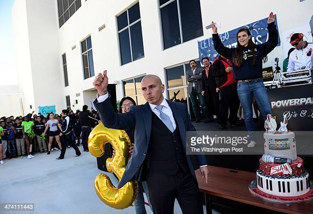 Armando Perez also known as Pitbull thanks the crowd after taking a bite of birthday cake given to him by the students and staff at SLAM Miami during...