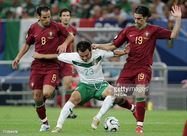 Armando Petit and Cardoso Tiago of Portugal surround Luis Perez of Mexico during the FIFA World Cup Germany 2006 Group D match between Portugal and...